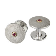 Silver and gold cufflinks with ruby